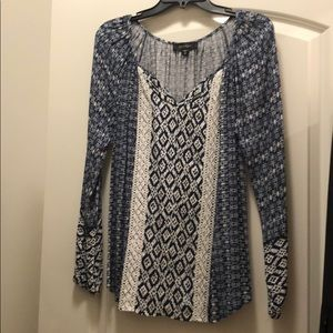 Navy and white pattern blouse with vertical lace